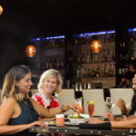 Four Ladies Enjoying Drinks and a Meal at the Aqua
